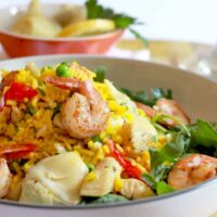 Shrimp and chicken paella salad served in a bowl.