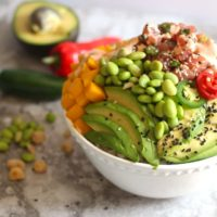 This Ahi Tuna Poke Bowlrecipe is so easy to make at home! Light, fresh, healthy and delicious!Loaded with fresh Ahi Tuna with citrus ponzu sauce, rice, cucumbers, avocado, edamame and mango. Drizzled with creamy sriracha sauce and topped with crunchy nuts. This Ahi Poke bowl is amazing!