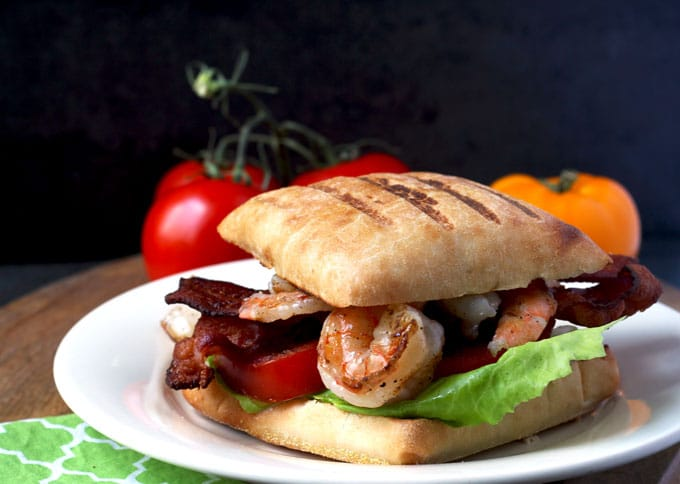 This Grilled Shrimp BLT Panini is so flavorful! Perfectly grilled shrimp with a delicious and creamy herb aioli elevate the classic BLT to new levels!