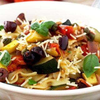 Super quick and easy pasta with sautéed garden vegetables, garlic infused olive oil, Kalamata olives, capers, basil and Parmesan cheese.