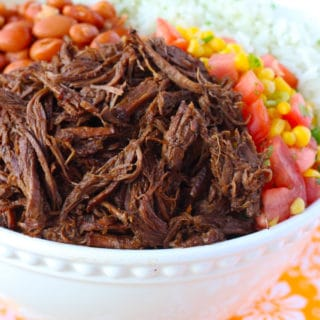 This Chipotle Barbacoa Beef is bursting with flavor. Seared beef cooks in a rich and smoky braising mixture until melt in your mouth fork tender. This Barbacoa Beef is always a crowd pleaser!