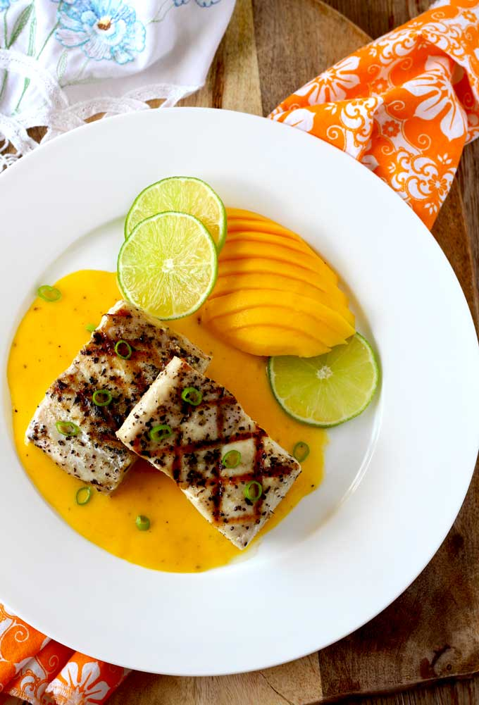 Grilled Mahi Mahi with Mango Lime Butter Sauce is easy enough for week night meals and elegant enough for special occasions