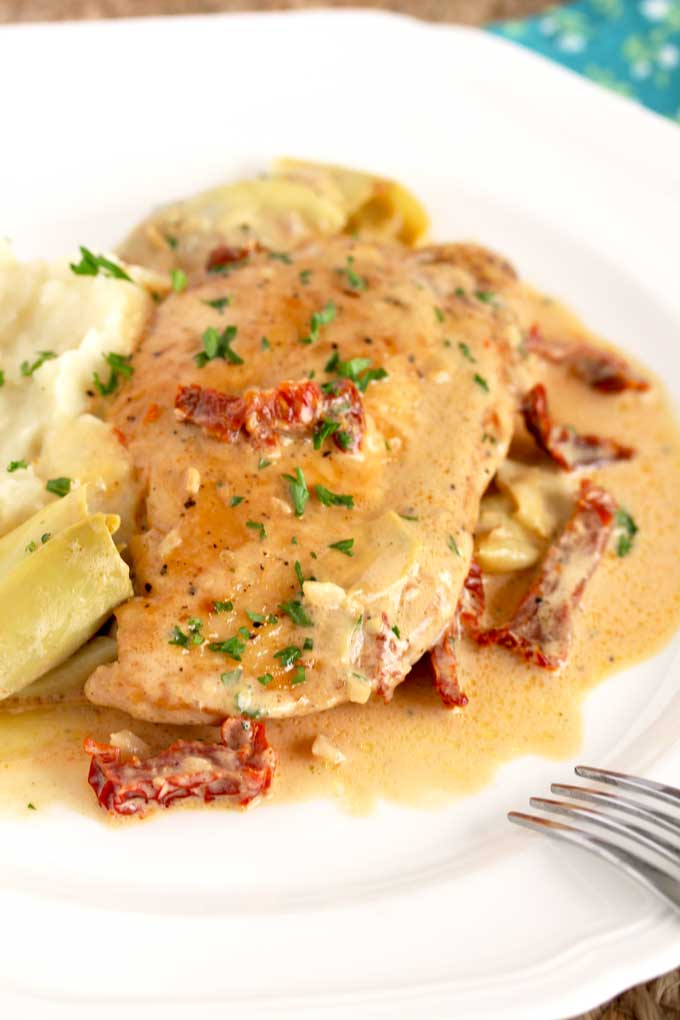 Golden pan seared Creamy Chicken and sun-dried tomatoes with mashed potatoes.