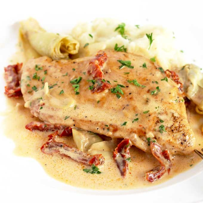 Creamy Chicken pan seared and served with a creamy artichoke and sun dried tomato sauce.