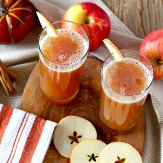 Harvest Shandy served in tall glasses and garnished with sliced apples.