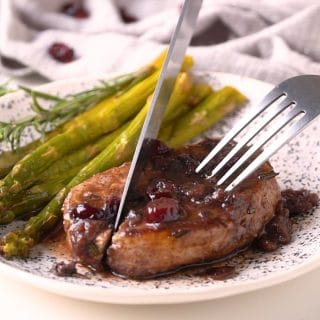 These Skillet Pork Chops are juicy, tender and easy to make. Boneless pork chops are seasoned with fresh rosemary, seared to perfection and topped with the tastiest Port wine and cranberry pan sauce.