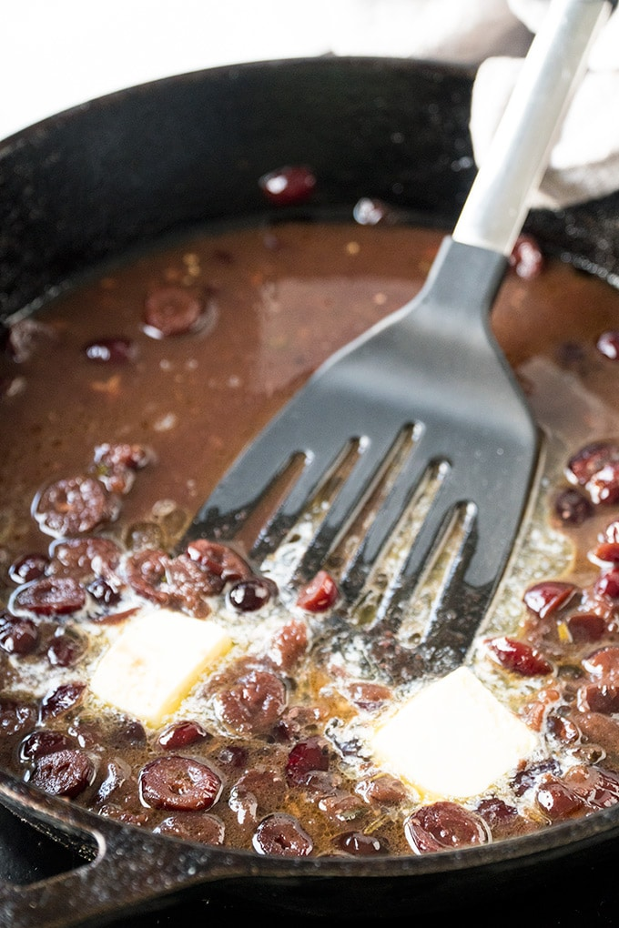 Port Wine and Cranberry Sauce been made in a skillet.