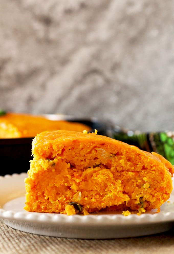 Not too spicy and super cheesy, this Skillet Cheddar Jalapeno Sweet Potato Cornbread is moist and savory with a little hint of natural sweetness from the oven roasted sweet potatoes.