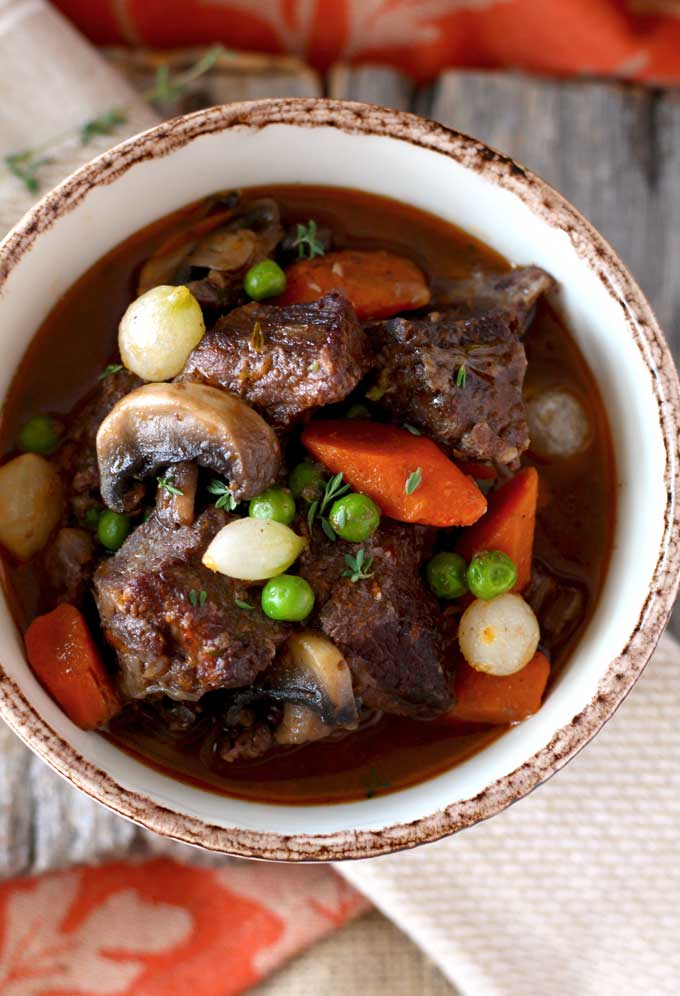 Overhead view of a bowl of beef stew in red wine.