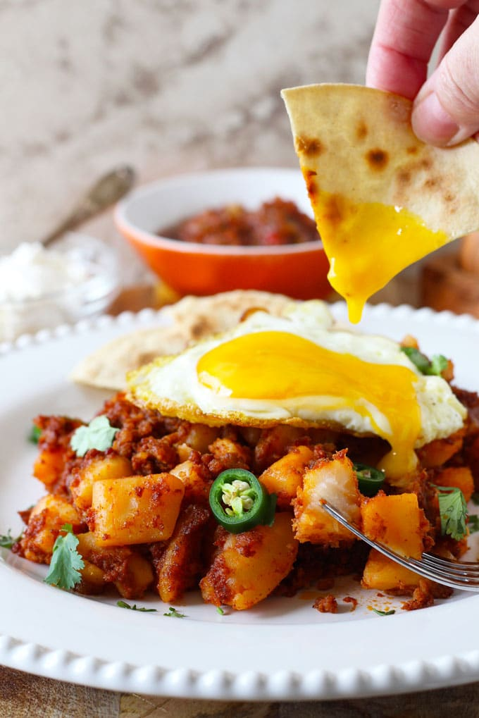 Crispy bits of chorizo, tender potatoes, and a world of flavor! This Potato and Chorizo Hash is a one-pan easy and delicious breakfast (or dinner)!