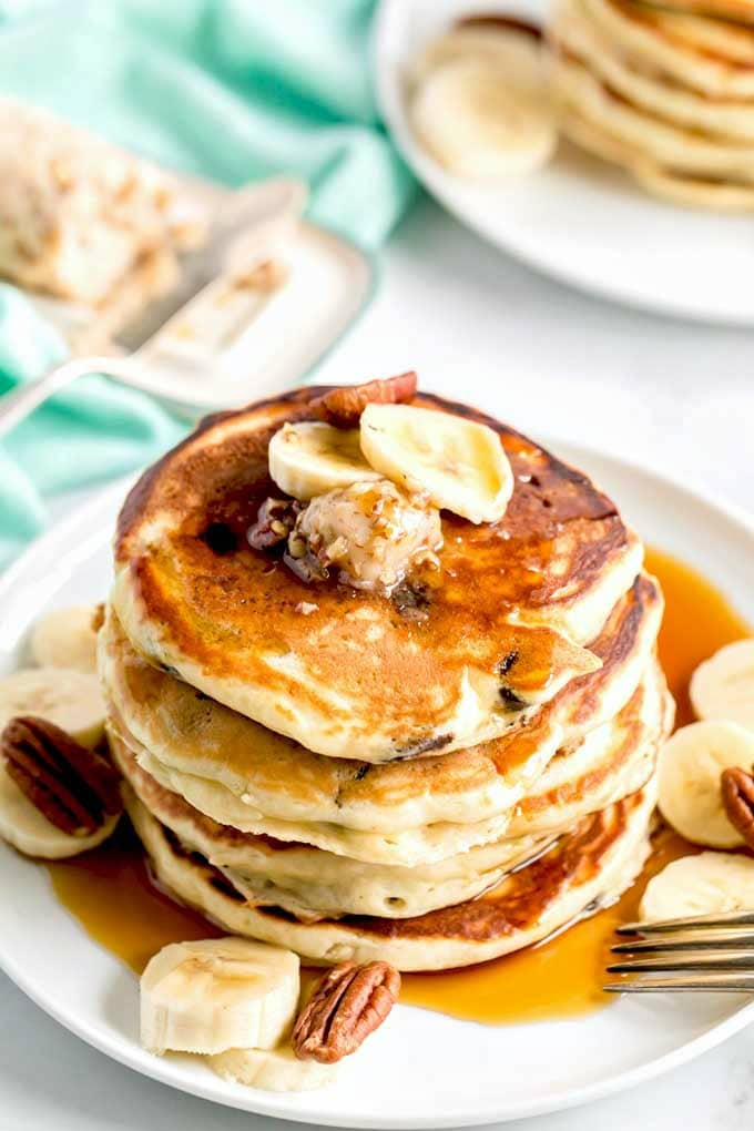 Pancakes topped with flavored butter on a white dish