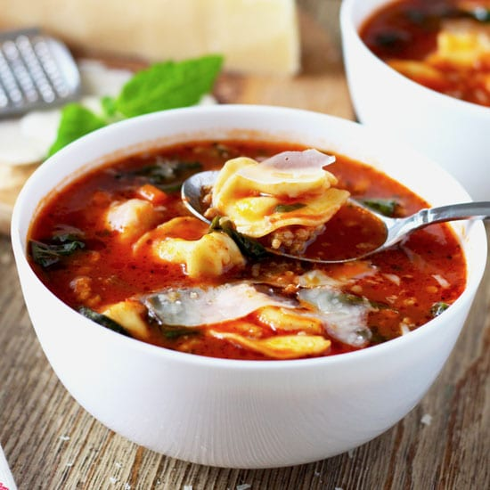 Italian Tomato Tortellini Soup ALT: This one-pot Italian Tomato Tortellini soup is easy to make, healthy and hearty. Italian sausage, spinach and cheese tortellini make this a great and quick meal for all to enjoy.