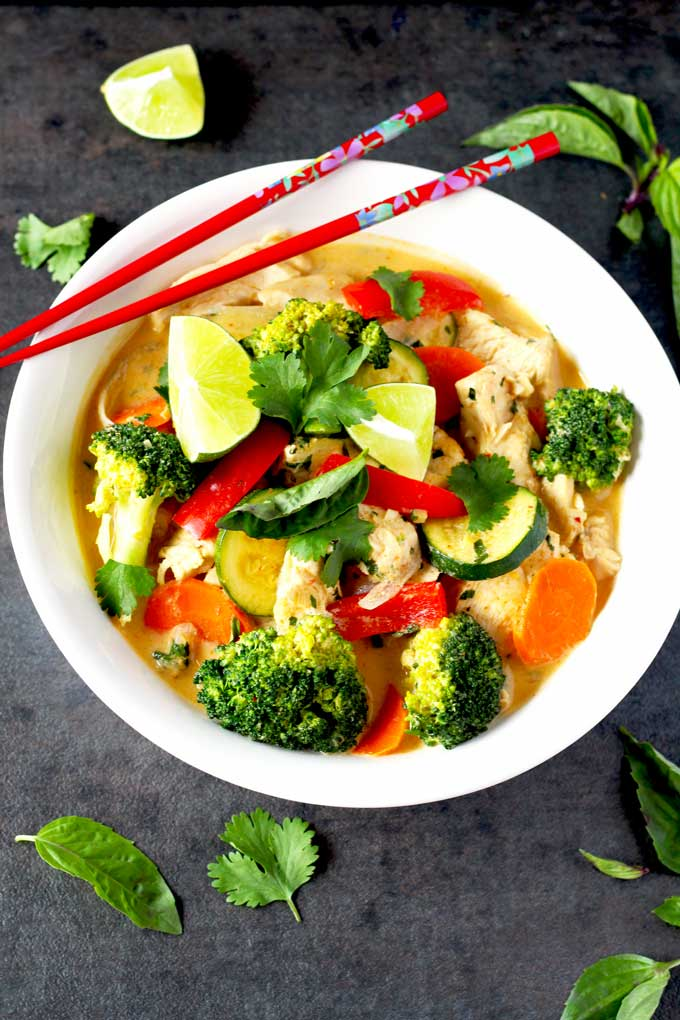 A white bowl with Thai Red Crurry Chicken with vegetables