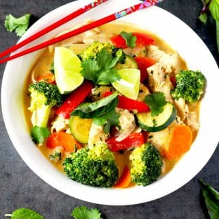 Thai Red Curry Chicken with Vegetables in a white bowl