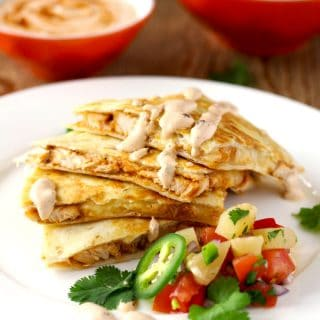 This easy to make Tex Mex inspired BBQ Chicken Quesadilla with Smoked Gouda Cheese is packed with super flavorful chicken and gooey cheese. Served with a delicious and fruity pineapple salsa and topped with a spicy and smoky Chipotle Crema! Let's sum that up in one word ~ Amazing!