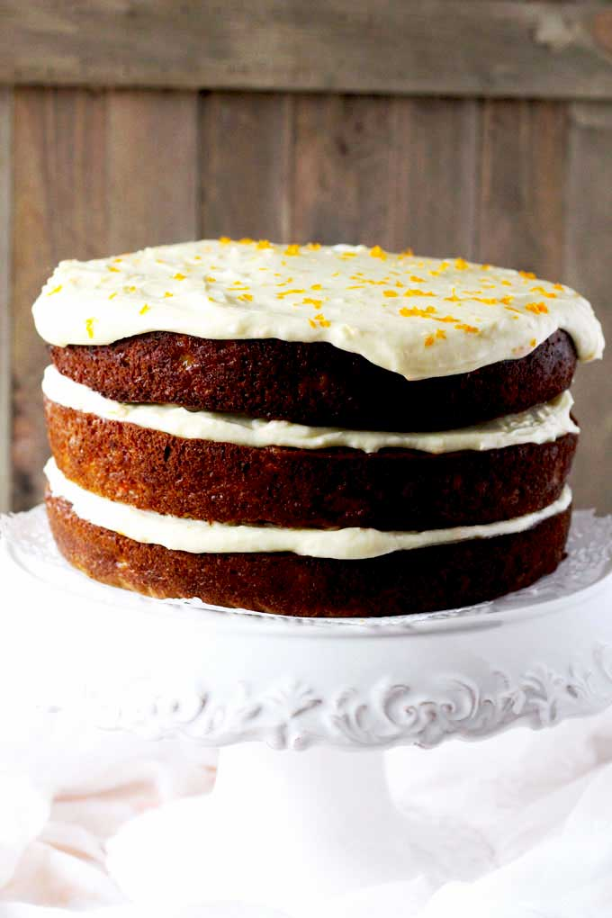 A whole 3 layer carrot cake with orange grand marnier cream cheese frosting.