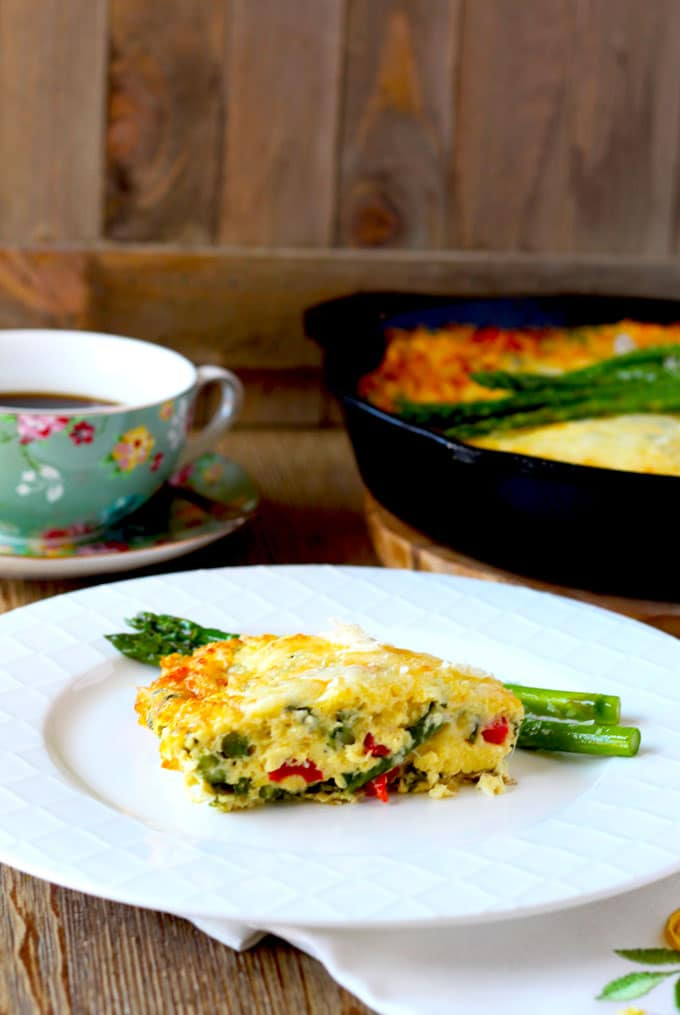 This easy to make Asparagus Frittata is the perfect egg dish for breakfast or brunch. Basil and Parmesan Cheese gives this delicious dish an Italian flare! Easy enough to make for your family and elegant enough for entertaining!