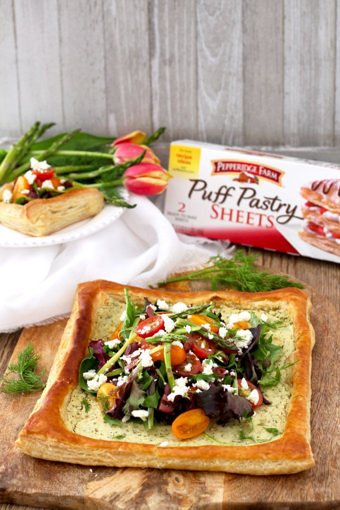 This perfectly golden brown and flaky Puff Pastry Tart with Tomatoes, Asparagus and Herbed Feta is delicious, easy to make and perfect served as an appetizer or lunch.