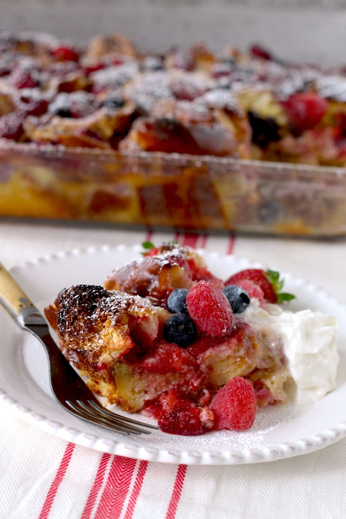 Easy to make, rich, decadent and full of berries. This Very Berry Bread Pudding is delicious and the perfect make ahead dish to enjoy for dessert, breakfast or brunch!