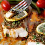Wild Cod, Green Beans and Tomatoes are roasted to perfection with super flavorful Herb, Lemon and Garlic Chermoula Sauce. This Moroccan inspired flavor-packed baked cod recipe is cooked in less than 22 minutes!