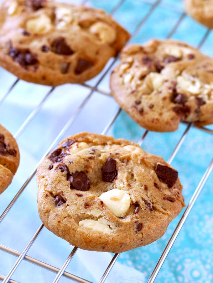 Close-up shot of White and Dark Chocolate Chunk Cookies in a cooling rack