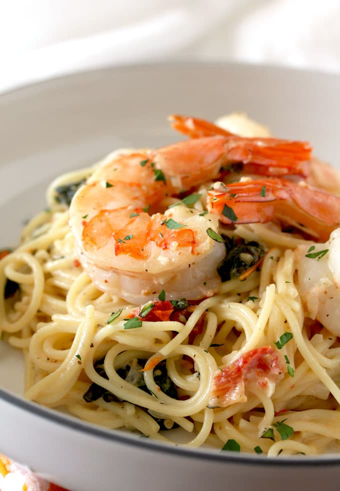 Close up view of Tuscan Shrimp over pasta