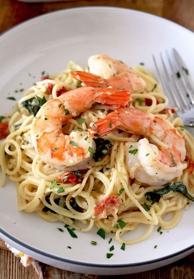 Tuscan Shrimp over a bed of pasta