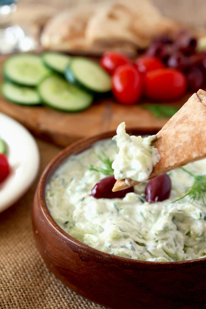 Greek Tzatziki Sauce is made from just a few ingredients. Fresh cucumbers and Greek yogurt are the base of this fresh, light and healthy sauce. Perfect as a dip, condiment or as an accompaniment to many Mediterranean dishes.