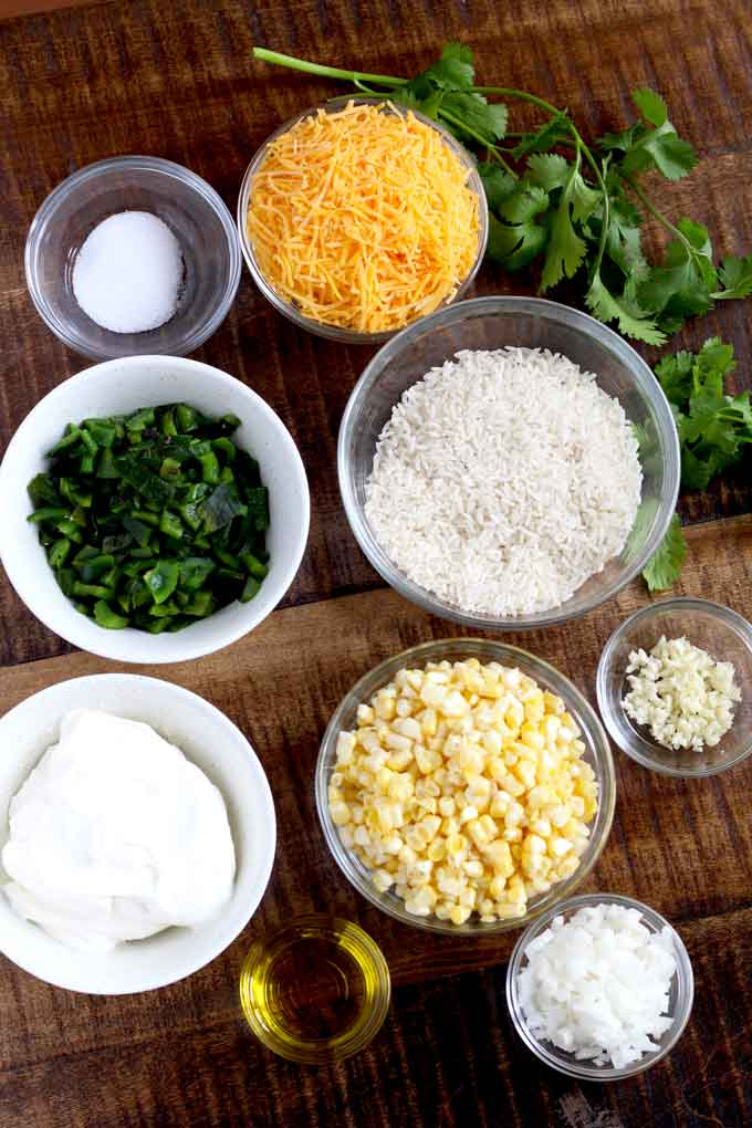 Ingredients to make this rice casserole on a wooden board.