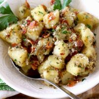 Soft and velvety in the middle with browned crispy edges these Parmesan Herb Easy Skillet Potatoes with bacon are delicious and easy to make. Perfect served as a side dish, as part of breakfast or brunch!