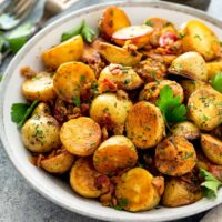 Golden skillet potatoes on a plate