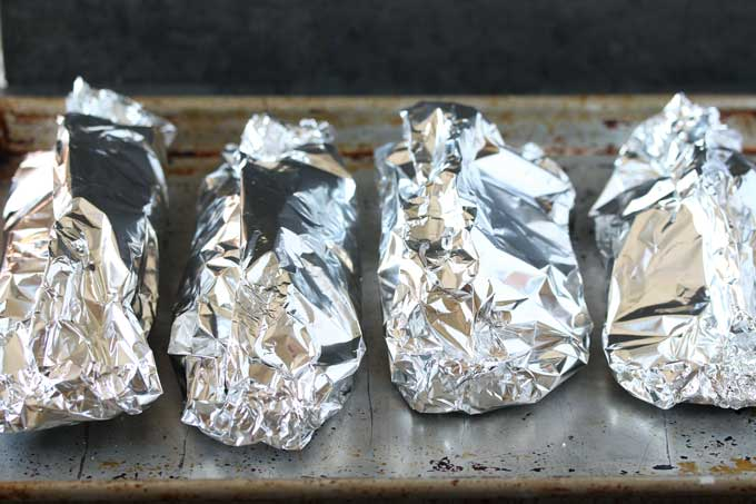 Foil packets on a sheet pan