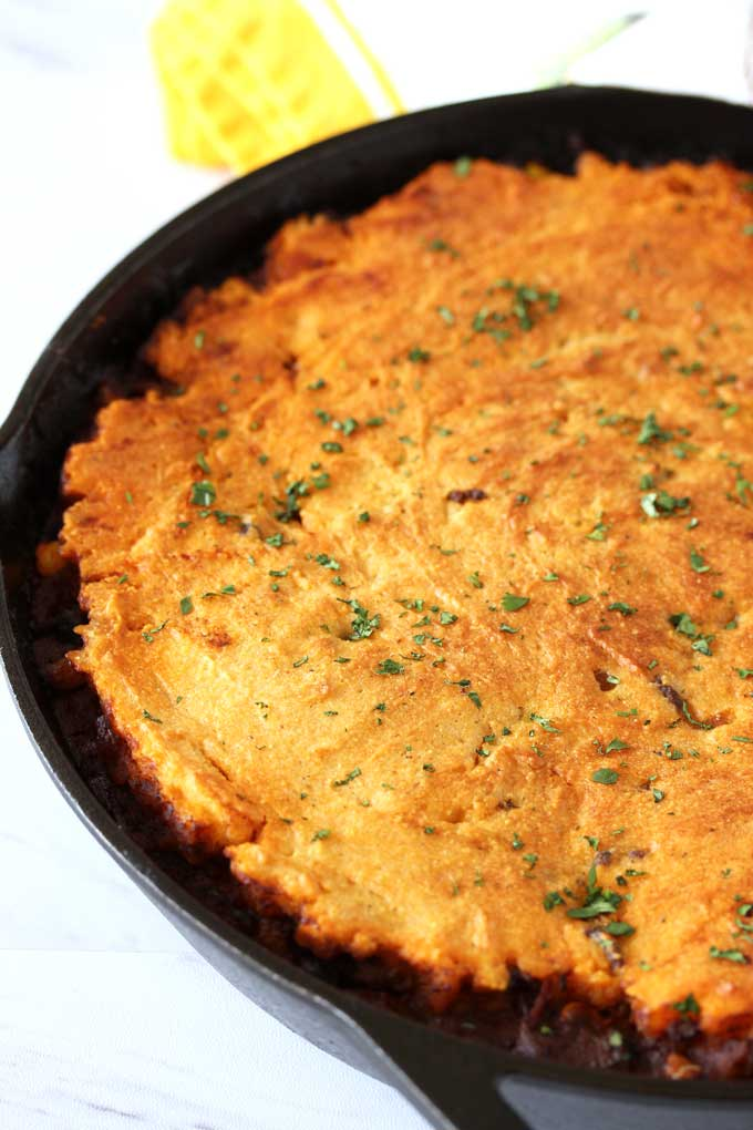 Tamale pie out of the oven has a golden cornbread topping