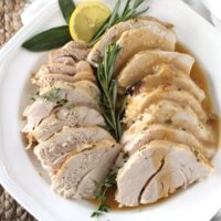 Sliced turkey breast with gravy on a platter