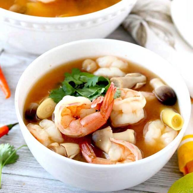 Tom Yum Soup with Shrimp in a white bowl