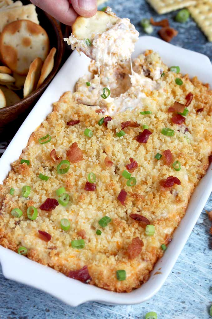Bacon dip scooped by a cracker.