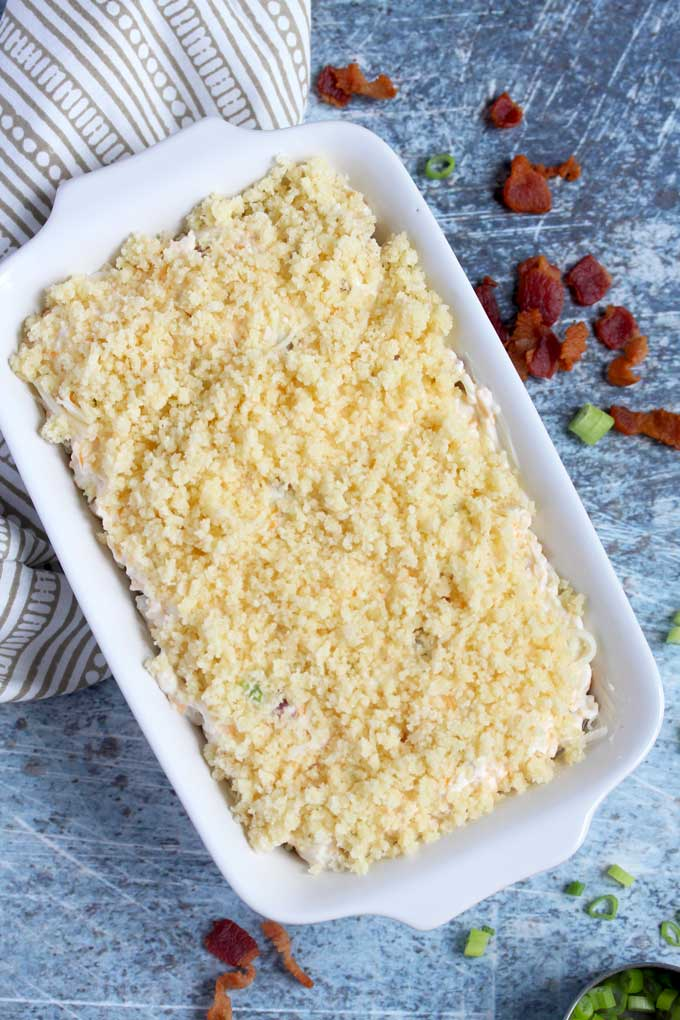 Bacon Dip with topping in a baking dish.