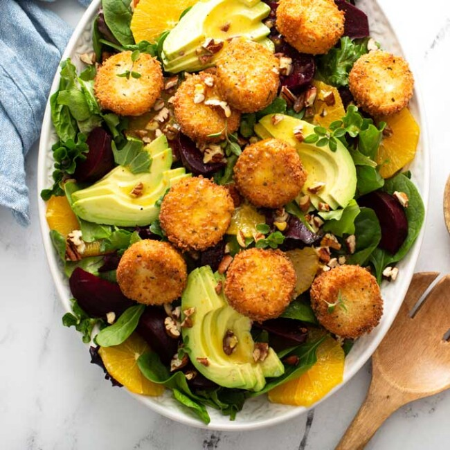 Roasted Beets, orange slices, avocado slices and crispy goat cheese over salad greens.