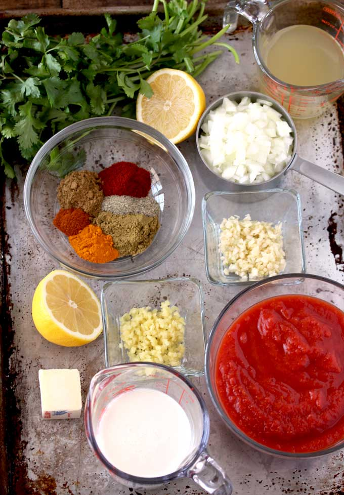 Picture here the ingredients to make Chicken Masala on a tray.