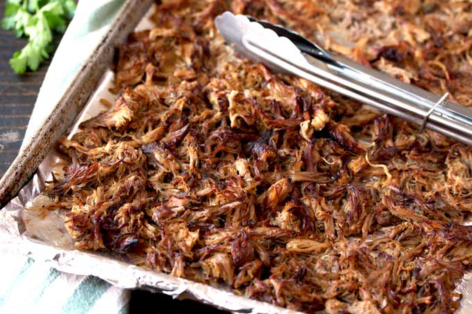 Close up view of the shredded pork carnitas showing the golden brown crispy edges