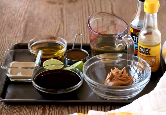 View of a tray with ingredients for the peanut Sesame Dressing.