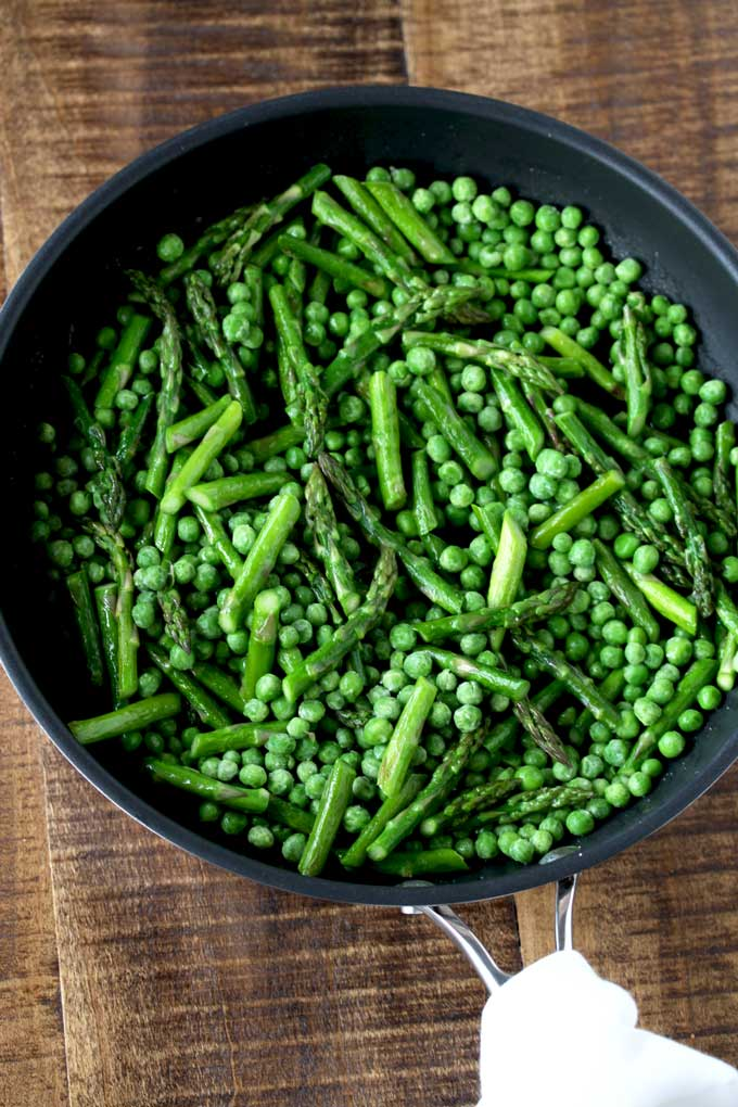 Asparagus and peas in a saute pan