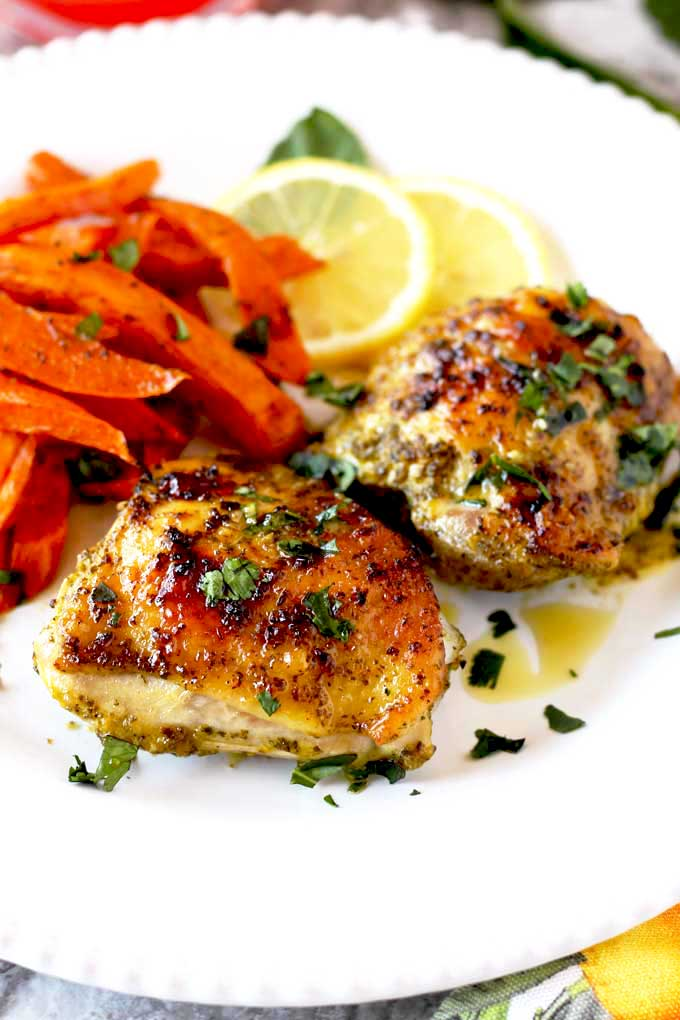 Chicken Thighs with Lemon and Herb served with sweet potato fries.