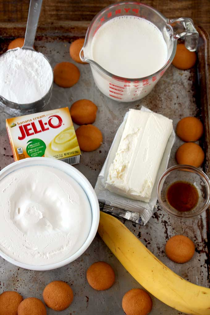 Pictured here ingredients to make Banana Cream Pie Dip. Pudding, Half & Half, Whip topping, cream cheese, vanilla, powdered sugar, bananas, nilla wafers.