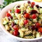 This Tuna Pasta Salad is mayo-free, delicious and quick to make. Tossed in a light lemon, yogurt and herb vinaigrette, with canned tuna, cherry tomatoes, cucumbers, mild diced red onions, Kalamata olives and capers. This Mediterranean Tuna Pasta Salad is the perfect lunch, light dinner or side dish to serve at your next gathering!