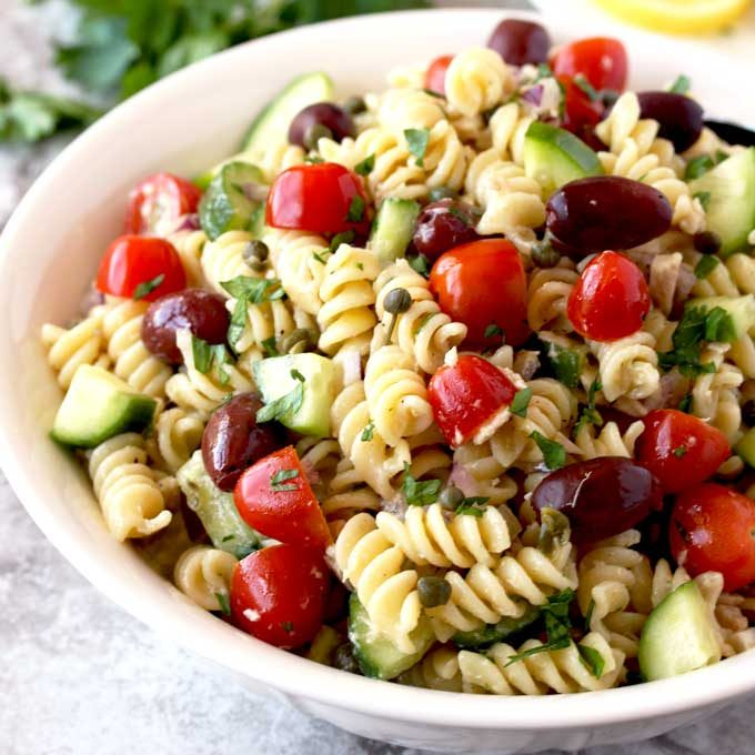 Close up view of Pasta Salad served in a white bowl