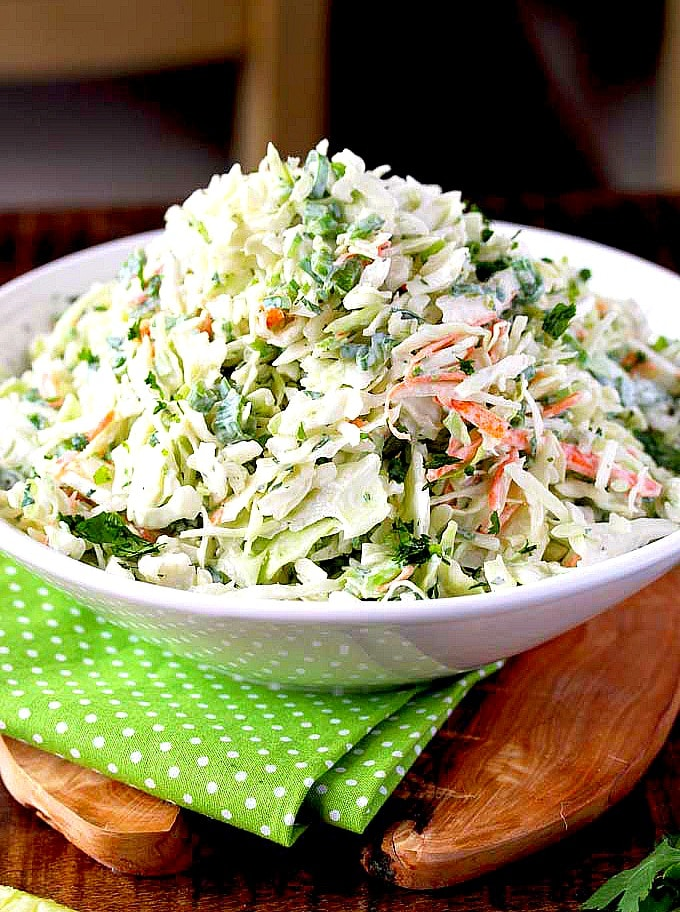Cilantro Lime Coleslaw pile up high in a white bowl