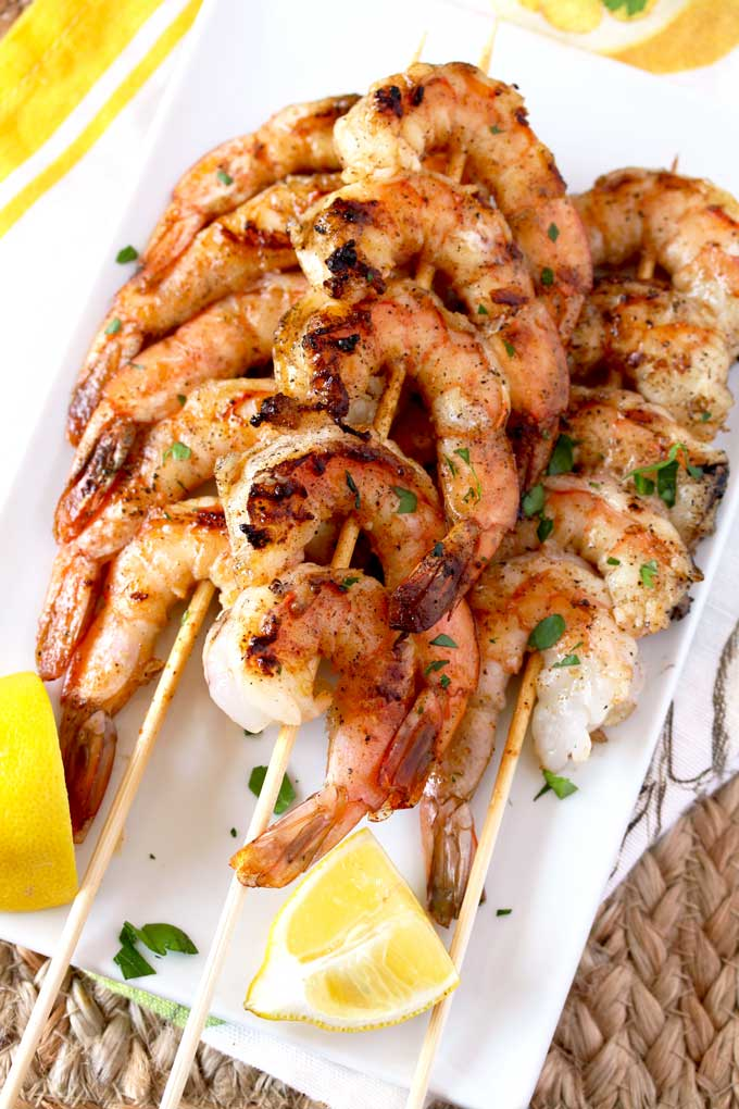 Skewers of grilled shrimp on a plate.