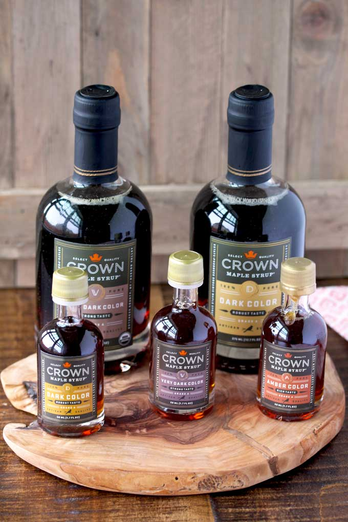 A colletion of Crown Maple Syrups in large and small bottles