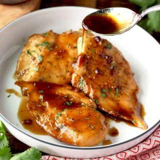 This Maple Balsamic Glazed Chicken is a delicious one-pan, quick and easy chicken dinner recipe sure to please even picky eaters!  Boneless chicken breasts are seared to perfection and then coated with a tasty and sweet maple-balsamic glaze!